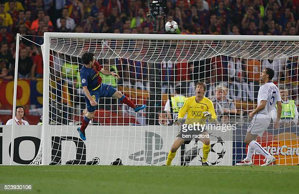 Lionel Messi of Barcelona beats goalkeeper Edwin van der Sar of Manchester United with a header to score the second goal during the UEFA Champions...