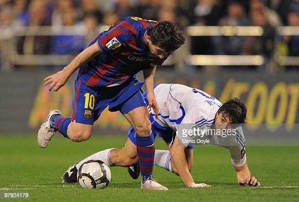 Lionel Messi of Barcelona beats Matteo Contini of Real Zaragoza during the La Liga match between Real Zaragoza and Barcelona at La Romareda stadium...