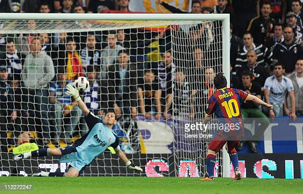 Lionel Messi of Barcelona beats Real Madrid's goalkeeper Iker Casillas from the penalty spot to score Barcelona's opening goal tduring the La Liga...