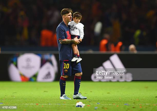 Lionel Messi of Barcelona carries his son Thiago following the UEFA Champions League Final between Juventus and FC Barcelona at Olympiastadion on...