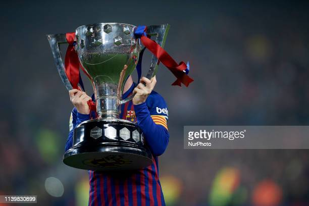 Lionel Messi of Barcelona celebrates after Barcelona won their 26th league title at the end of the Spanish League football match between Barcelona...