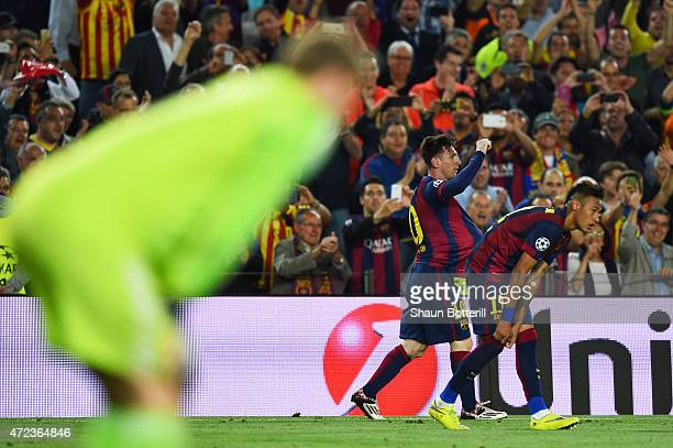 Lionel Messi of Barcelona celebrates after scoring a goal as a dejected Manuel Neuer of Bayern Muenchen looks on during the UEFA Champions League...