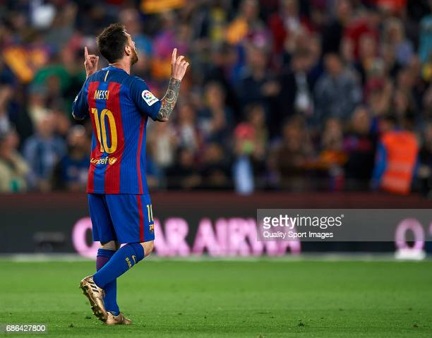Lionel Messi of Barcelona celebrates after scoring a goal during the La Liga match between FC Barcelona and SD Eibar at Camp Nou Stadium on May 21...