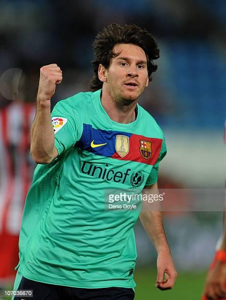 Lionel Messi of Barcelona celebrates after scoring Barcelona's opening goal during the La Liga match between UD Almeria and Barcelona at Estadio del...