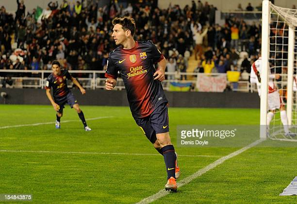 Lionel Messi of Barcelona celebrates after scoring his side's 5th goal during the La Liga match between Rayo Vallecano and Barcelona at Estadio...