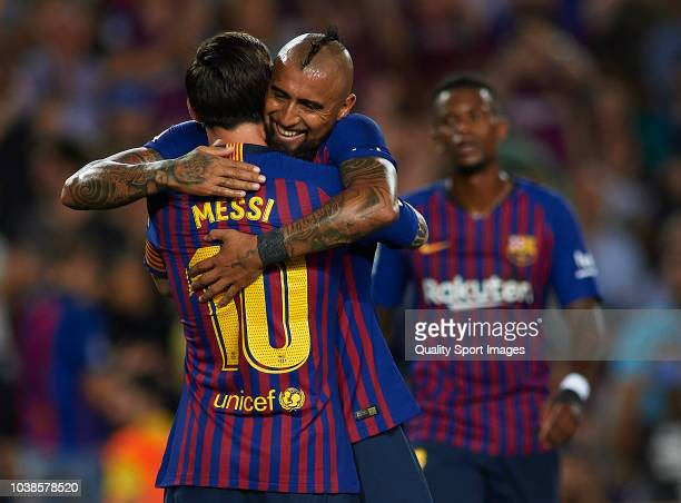 b8e31a854 Lionel Messi of Barcelona celebrates after scoring his sides first goal with  his teammate Arturo Vidal