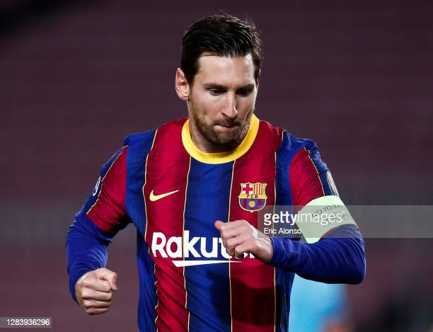 Lionel Messi of Barcelona celebrates after scoring his sides first goal from the penalty spot during the UEFA Champions League Group G stage match...