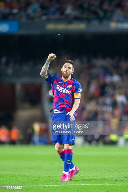 Lionel Messi of Barcelona celebrates after scoring his sides fourth goal from a free kick during the Barcelona V Sevilla La Liga regular season match...