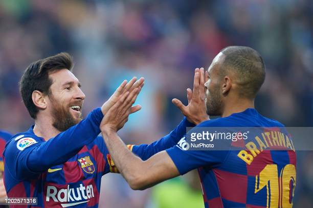 Lionel Messi of Barcelona celebrates after scoring his sides goal whit Martin Braithwaite during the Liga match between FC Barcelona and SD Eibar SAD...