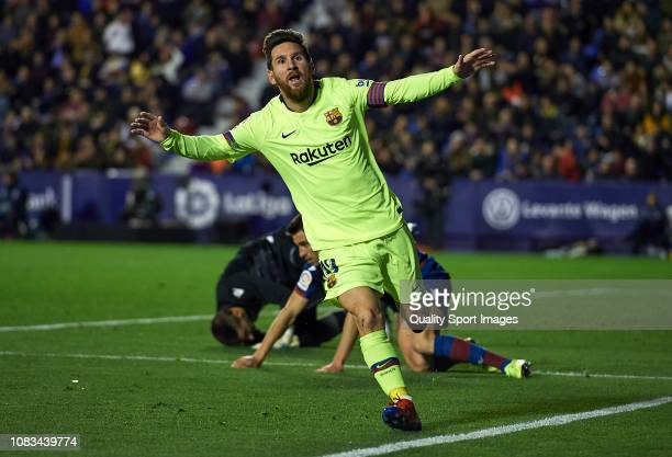 Lionel Messi of Barcelona celebrates after scoring his sides second goal during the La Liga match between Levante UD and FC Barcelona at Ciutat de...