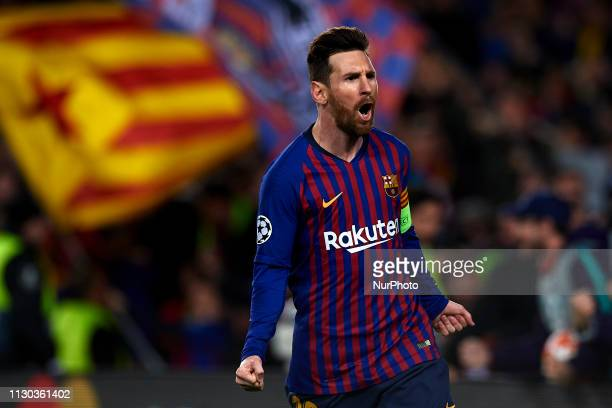 Lionel Messi of Barcelona celebrates after scoring his sides second goal during the UEFA Champions League Round of 16 Second Leg match between FC...