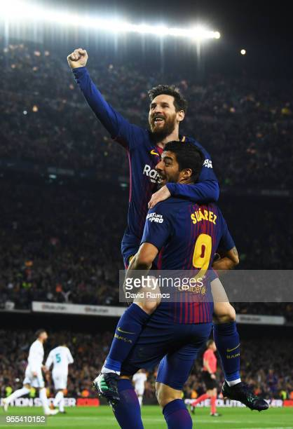 Lionel Messi of Barcelona celebrates after scoring his sides second goal with Luis Suarez of Barcelona during the La Liga match between Barcelona and...