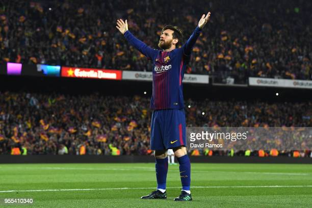 Lionel Messi of Barcelona celebrates after scoring his sides second goal during the La Liga match between Barcelona and Real Madrid at Camp Nou on...