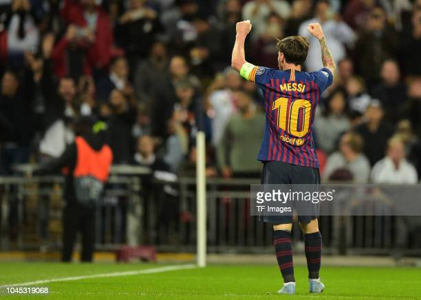 Lionel Messi of Barcelona celebrates after scoring his sides third goal during the Group B match of the UEFA Champions League between Tottenham...