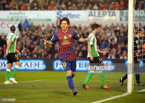 Lionel Messi of Barcelona celebrates after scoring his team's 2nd goal during the La Liga match between Real Racing Club and Barcelona at El...