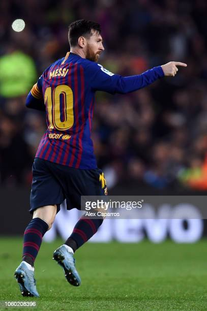 Lionel Messi of Barcelona celebrates after scoring his team's first goal during the La Liga match between FC Barcelona and Real Betis Balompie at...