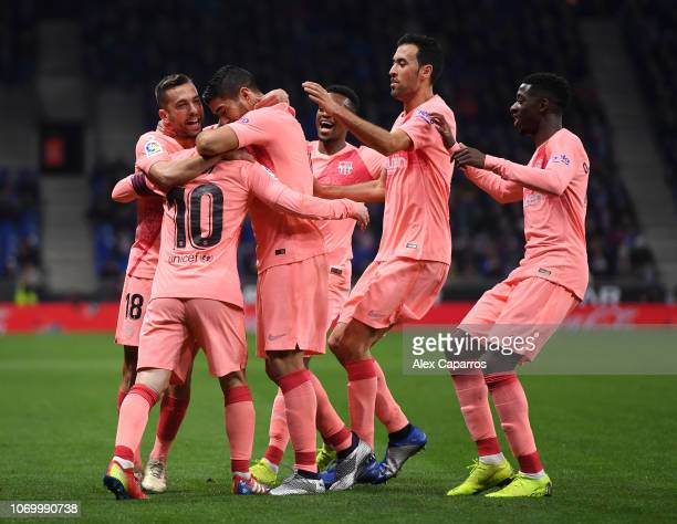 Lionel Messi of Barcelona celebrates after scoring his team's first goal with his team mates during the La Liga match between RCD Espanyol and FC...