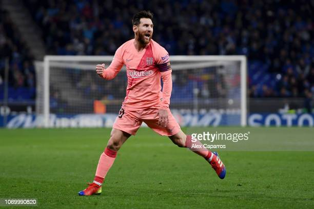 Lionel Messi of Barcelona celebrates after scoring his team's first goal during the La Liga match between RCD Espanyol and FC Barcelona at RCDE...