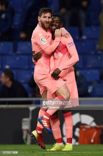 Lionel Messi of Barcelona celebrates after scoring his team's first goal with Ousmane Dembele of Barcelona during the La Liga match between RCD...
