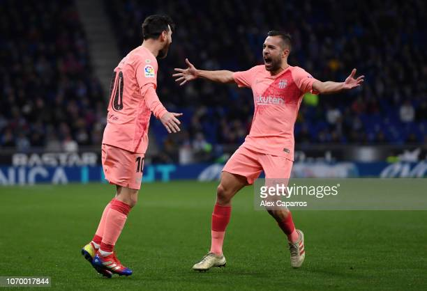 Lionel Messi of Barcelona celebrates after scoring his team's first goal with Jordi Alba of Barcelona during the La Liga match between RCD Espanyol...