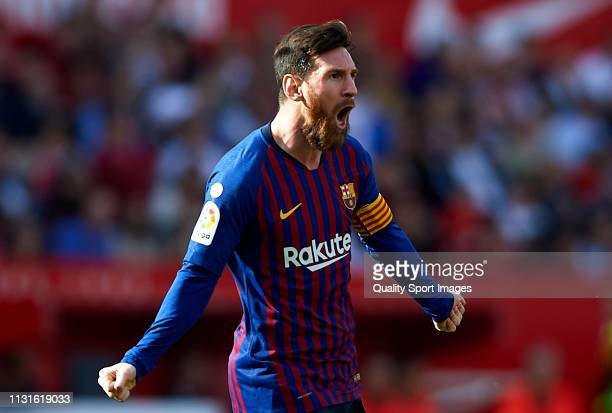 Lionel Messi of Barcelona celebrates after scoring his team's first goal during the La Liga match between Sevilla FC and FC Barcelona at Estadio...