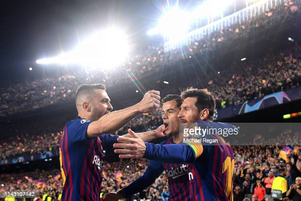 Lionel Messi of Barcelona celebrates after scoring his team's first goal with Philippe Coutinho of Barcelona and Jordi Alba of Barcelona during the...