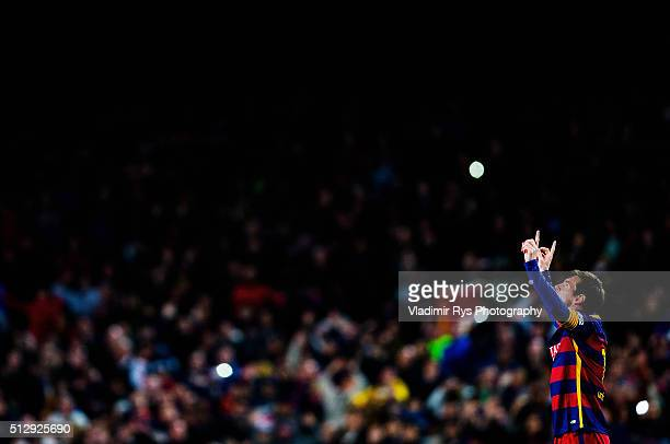 Lionel Messi of Barcelona celebrates after scoring his team's first goal during the La Liga match between FC Barcelona and Sevilla FC at Camp Nou on...