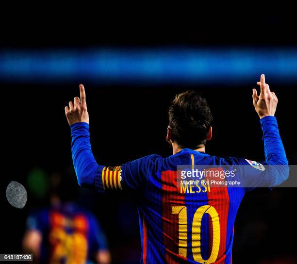 Lionel Messi of Barcelona celebrates after scoring his team's first goal during the La Liga match between FC Barcelona and RC Celta de Vigo at Camp...