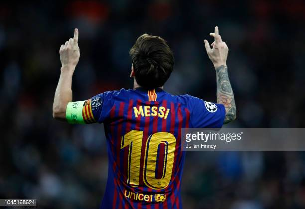 Lionel Messi of Barcelona celebrates after scoring his team's fourth goal during the Group B match of the UEFA Champions League between Tottenham...
