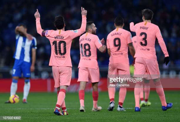 Lionel Messi of Barcelona celebrates after scoring his team's fourth goal during the La Liga match between RCD Espanyol and FC Barcelona at RCDE...