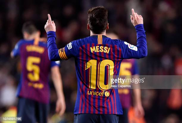 Lionel Messi of Barcelona celebrates after scoring his team's second goal during the La Liga match between FC Barcelona and RC Celta de Vigo at Camp...