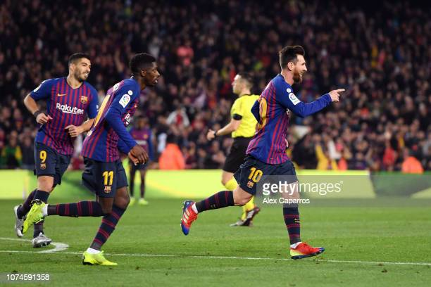 Lionel Messi of Barcelona celebrates after scoring his team's second goal followed by teammates Ousmane Dembele and Luis Suarez during the La Liga...