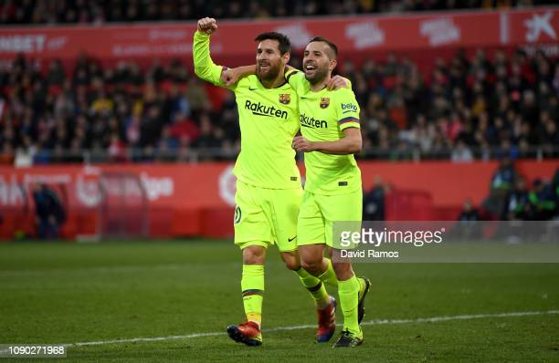 Lionel Messi of Barcelona celebrates after scoring his team's second goal with Jordi Alba of Barcelona during the La Liga match between Girona FC and...