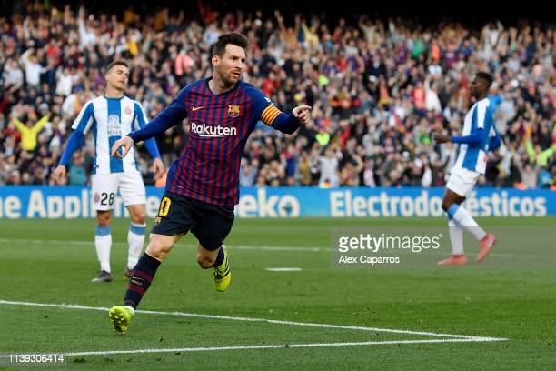 Lionel Messi of Barcelona celebrates after scoring his team's second goal during the La Liga match between FC Barcelona and RCD Espanyol at Camp Nou...