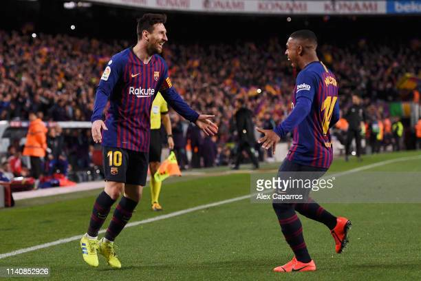Lionel Messi of Barcelona celebrates after scoring his team's second goal with Malcom during the La Liga match between FC Barcelona and Club Atletico...
