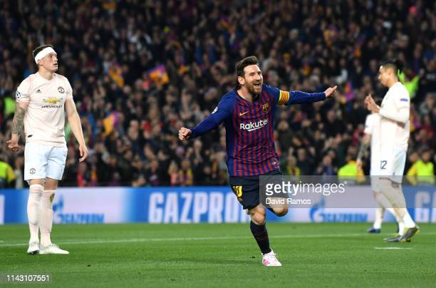 Lionel Messi of Barcelona celebrates after scoring his team's second goal as Phil Jones of Manchester United reacts during the UEFA Champions League...