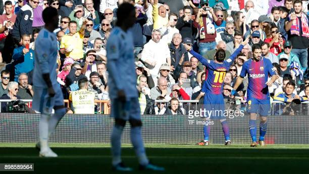 Lionel Messi of Barcelona celebrates after scoring his team`s second goal with team mates during the La Liga match between Real Madrid and Barcelona...