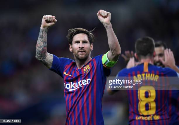 Lionel Messi of Barcelona celebrates after scoring his team's third goal during the Group B match of the UEFA Champions League between Tottenham...