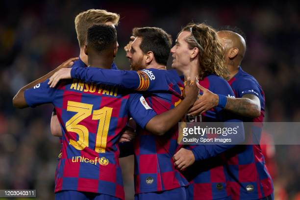 Lionel Messi of Barcelona celebrates after scoring his team's third goal with his teammates during the Copa del Rey Round of 16 match between FC...