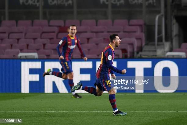 Lionel Messi of Barcelona celebrates after scoring their side's first goal during the La Liga Santander match between FC Barcelona and Athletic Club...