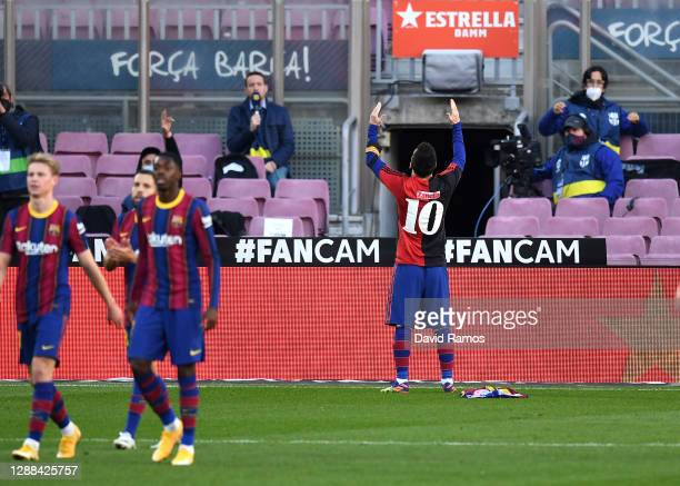 Lionel Messi of Barcelona celebrates after scoring their sides fourth goal while wearing a Newell's Old Boys shirt with the number 10 on the back in...