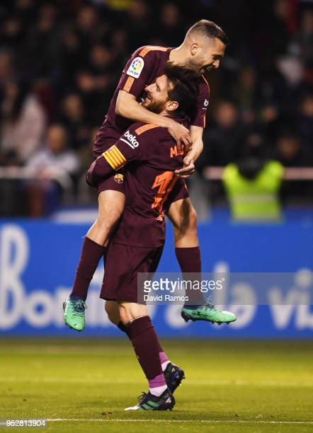Lionel Messi of Barcelona celebrates as he scores his sides fourth goal with Jordi Alba during the La Liga match between Deportivo La Coruna and...