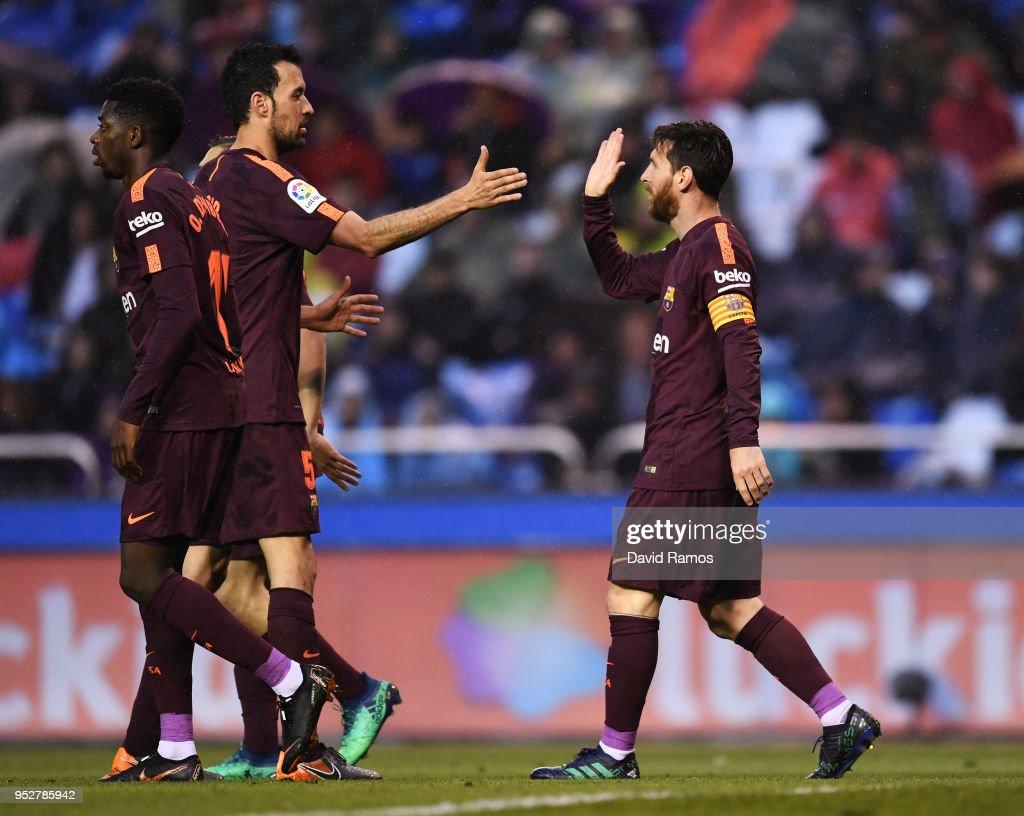Lionel Messi of Barcelona celebrates as he scores his sides second goal with Sergio Busquets of Barcelona during the La Liga match between Deportivo La Coruna and Barcelona at Estadio Riazor on April 29, 2018 in La Coruna, Spain.