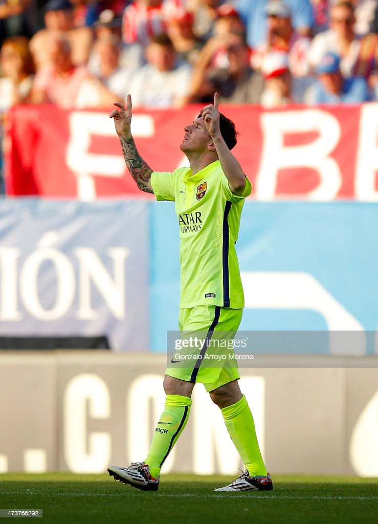 Lionel Messi of Barcelona celebrates as he scores their first goal during the La Liga match between Club Atletico de Madrid and FC Barcelona at Vicente Calderon Stadium on May 17, 2015 in Madrid, Spain.