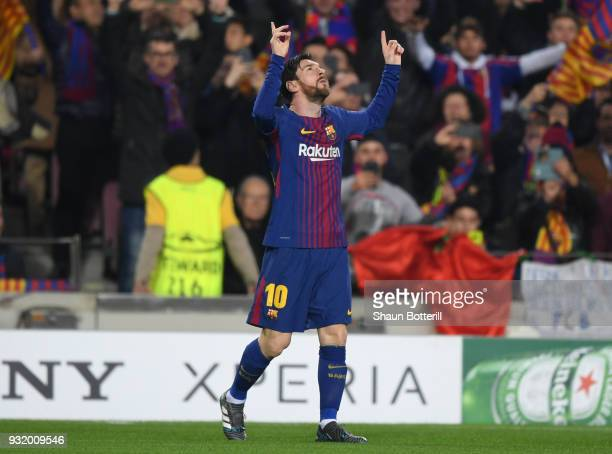 Lionel Messi of Barcelona celebrates as he scores their first goal during the UEFA Champions League Round of 16 Second Leg match FC Barcelona and...