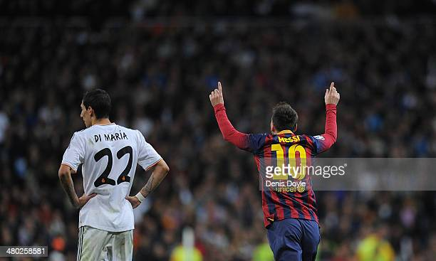 Lionel Messi of Barcelona celebrates beside Angel Di Maria of Real Madrid after scoring his team's third goal during the La Liga match between Real...