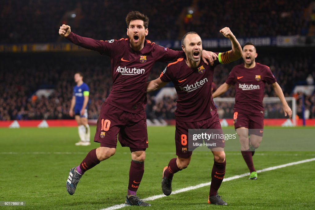 Lionel Messi of Barcelona celebrates his equaliser with team mate Andres Iniesta during the UEFA Champions League Round of 16 First Leg match between Chelsea FC and FC Barcelona at Stamford Bridge on February 20, 2018 in London, United Kingdom.
