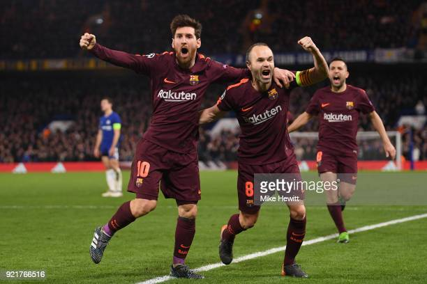 Lionel Messi of Barcelona celebrates his equaliser with team mate Andres Iniesta during the UEFA Champions League Round of 16 First Leg match between...