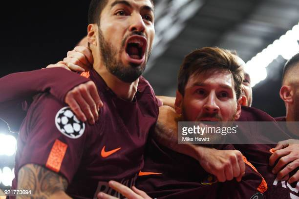 Lionel Messi of Barcelona celebrates his equaliser with team mate Luis Suarez during the UEFA Champions League Round of 16 First Leg match between...