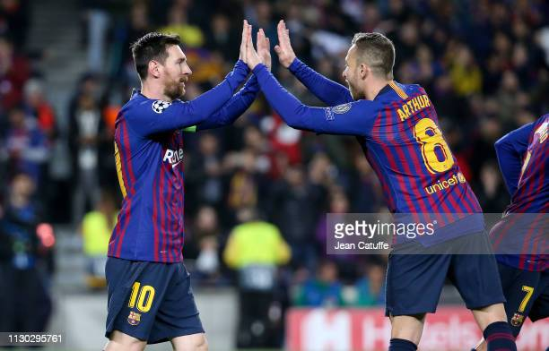 Lionel Messi of Barcelona celebrates his goal with Arthur Melo during the UEFA Champions League Round of 16 Second Leg match between FC Barcelona and...